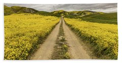 The Road Less Pollenated Beach Towel by Peter Tellone