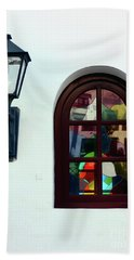 The Window And The Lantern Beach Towel by Lynn Bolt