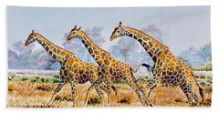 Three Giraffes Beach Towel