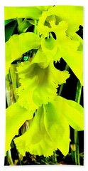 Three Orchids In Yellow Beach Towel