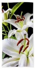 Three White Lilies Beach Towel by Garry Gay