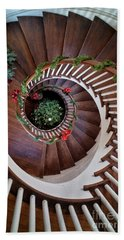 To The Bottom Of The Staircase Beach Towel by Nicki McManus