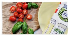 Beach Towel featuring the photograph Tomatoes On Yellow Plate by Rebecca Cozart