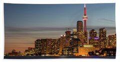 Beach Towel featuring the photograph Toronto Skyline At Dusk by Adam Romanowicz