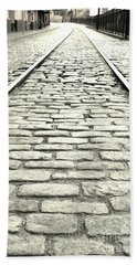 Tracks In The Road Beach Towel by Gary Smith