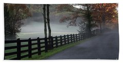 Tree Lined Road In The Fog Beach Towel