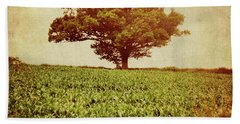 Beach Towel featuring the photograph Tree On Edge Of Field by Lyn Randle