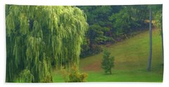 Trees Along Hill Beach Towel