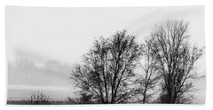 Trees In The Mist Beach Towel