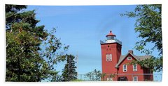 Two Harbors Lighthouse Beach Towel by Jimmy Ostgard
