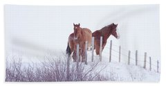 Two Horses In The Snow Beach Towel
