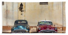 Beach Towel featuring the photograph Two Old Vintage Chevys Havana Cuba by Charles Harden