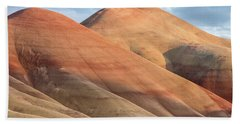 Two Painted Hills Beach Towel by Greg Nyquist