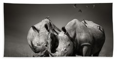 Two Rhinoceros With Birds In Bw Beach Towel
