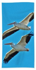 Two White Pelicans Beach Towel