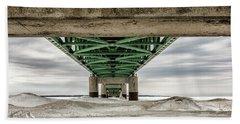 Beach Towel featuring the photograph Under Mackinac Bridge Winter by John McGraw