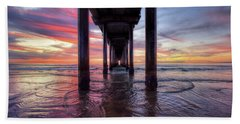 Under The Pier Sunset Beach Towel