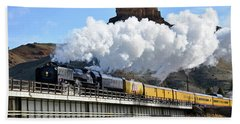 Union Pacific Steam Engine 844 And Castle Rock Beach Towel by Eric Nielsen