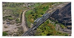 Beach Towel featuring the photograph Up Tracks Cross The Mojave River by Jim Thompson