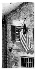 Beach Towel featuring the photograph Us Flag In Colonial Williamsbug by Emanuel Tanjala