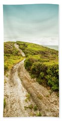 Vibrant Green Hills And Ocean Tracks Beach Towel