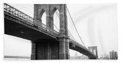 View Brooklyn Bridge With Foggy City In The Background Beach Towel