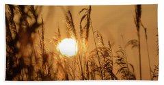 View Of Sun Setting Behind Long Grass B Beach Towel