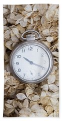 Beach Towel featuring the photograph Vintage Pocket Watch Over Dried Flowers by Edward Fielding