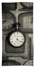 Beach Towel featuring the photograph Vintage Pocket Watch Over Old Clocks by Edward Fielding