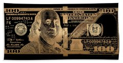 One Hundred Us Dollar Bill - $100 Usd In Gold On Black Beach Sheet