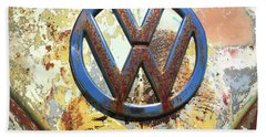 Beach Towel featuring the photograph Volkswagen Vw Emblem With Rust by Kelly Hazel