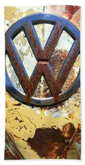 Beach Towel featuring the photograph Vw Volkswagen Emblem With Rust by Kelly Hazel