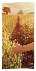 Beach Towel featuring the photograph Walking Through Wheat Field by Lyn Randle