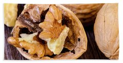 Walnuts On Wooden Table Beach Towel