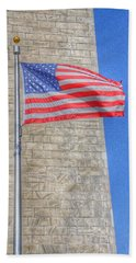 Washington Monument With The American Flag Beach Towel