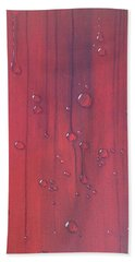Water Drops On Red Beach Sheet