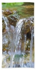Beach Towel featuring the photograph Water On The Rocks by Raphael Lopez