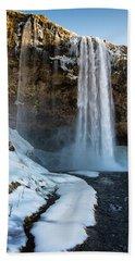 Waterfall Seljalandsfoss Iceland In Winter Beach Towel by Matthias Hauser
