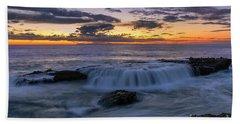 Wave Over The Rocks Beach Towel