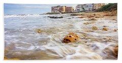 Waves Washing The Rocks Beach Towel