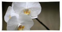 Wet White Orchids Beach Towel