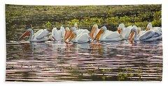 White Pelican Parade Beach Towel