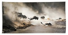 Wildebeest Leap Of Faith Into The Mara River Beach Towel
