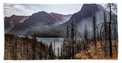 Beach Towel featuring the photograph Wildfire Remnants Overlooking St. Mary's Lake, Glacier National Park by Lon Dittrick