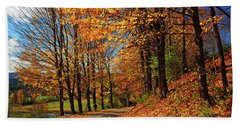 Winding Country Road In Autumn Beach Towel