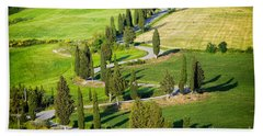 Winding Cypress Lined Road Of Monticchiello Beach Towel by IPics Photography