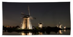 Windmills Illuminated At Night Beach Towel by IPics Photography