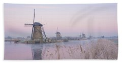 Windmills In The Netherlands In The Soft Sunrise Light In Winter Beach Towel
