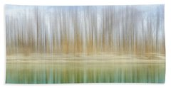 Winter Trees On A River Bank Reflecting Into Water Beach Towel