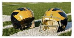 Wolverine Helmets From Different Eras On The Field Beach Sheet